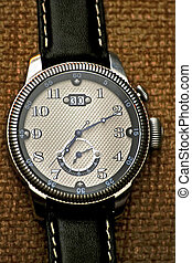 Chrome watch - Chrome analogue watch with perforated dial...