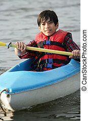 Kayaking on the lake - Ten year old boy kayaking on the...