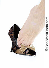 female\\\'s foot jumping from shoe