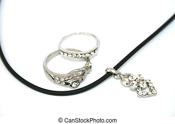 Two rings and necklace isolated on the white.