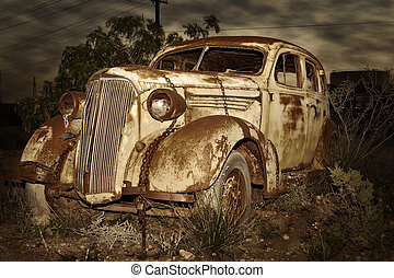 old rusted car at night
