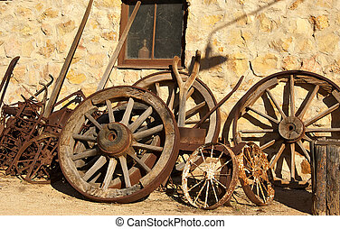 old wagon wheels against the wall
