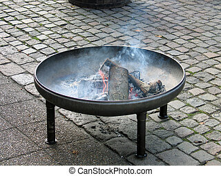 Fire pit with burning logs - Fire pit in classical design...