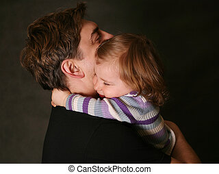 Daughter and father - The small daughter embraces the father
