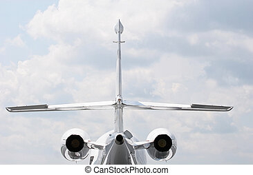 Jets From Rear - Rear view of a private jet with wings and...
