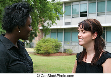 Students Chatting - two female students chatting in front of...