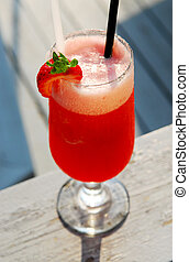 Strawberry daiquiri cocktail served in a cold glass outdoor