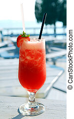 Strawberry daiquiri cocktail served in a cold glass on a...