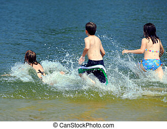 Children running into water - Group of young children...
