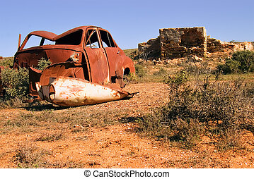 old car and ruins