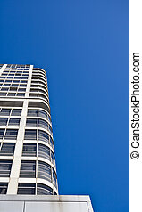 Corporate office tower with blue sky