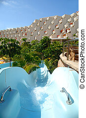 Water slide and hotel in the background.