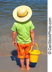Boy at the seaside, summer holidays, concept