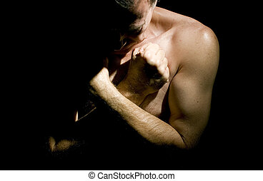 Humility - Man with arms folded across his chest and his...