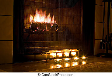 Warm fireplace - Romantic fireplace with candles burning in...