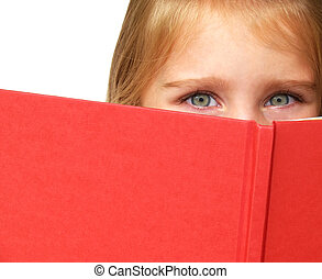 child reading a book - a little child\\\'s eyes looking over...