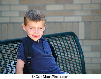 boy at school bus stop