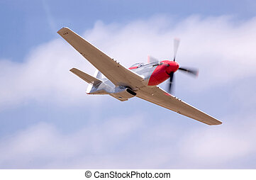 P51 Flyby - A restored P51 fighter airplane doing a fast...