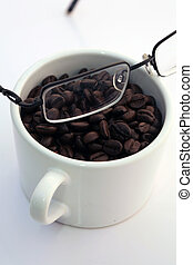 seeing coffee - a picture of a cup of coffe with glasses...