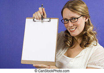 Blank Space - Young woman on blue holding a blank clipboard...