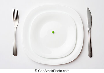 place setting with pea - close-up shot of place setting with...