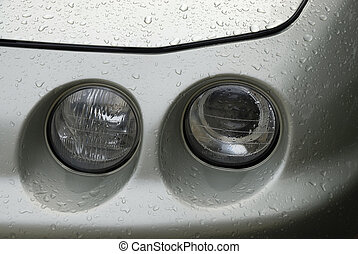 Head lights - Headlights of man automobile ona rainy day