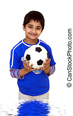 Kid with Soccer ball - A young handsome kid holding a soccer...