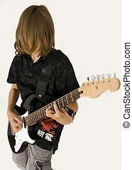 Teenaged guitar player - A photography of long haired...