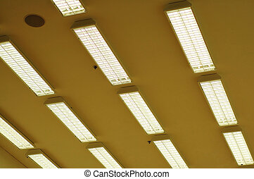 Row of fluorescent lamps - Rows of fluorescent lamps of...