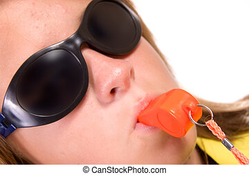 Sunglasses and safety whistle - Teen girl wearing dark...