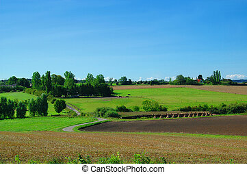 Idyllic Farm Landscape - Idyllic farm landscape with blue...