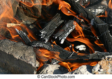 Camp Fire - A campfire made of burning wood evokes feelings...