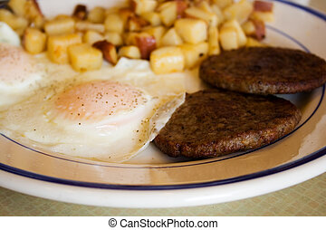 Fried Egg Breakfast with Sausage and Potatoes
