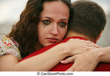 Tears of trust - The crying girl embraces the man