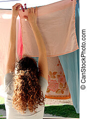 house wife and laundry - housewife or young woman attaching...
