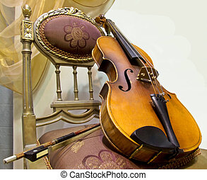 Violin - Old music instrument violin on the chair