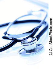 Stethoscope - A shot of a stethoscope over white