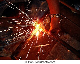Welding Sparks - Sparks from electric welding of an Iron...