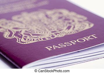 Passport - A closeup shot of a passport on a white...