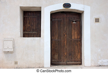 Wooden door and window in a house in south France, Europe