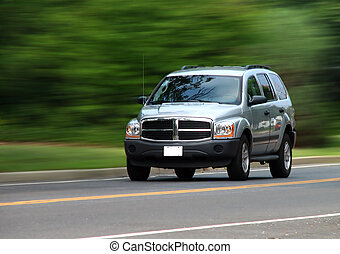 Speedy SUV - Silver SUV in motion 34 front angle view with...