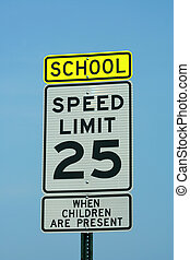 School and 25 mph sign against a blue sky