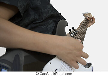 Teenaged guitar player - A photo of musician playing on...