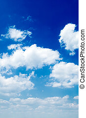 The white clouds. - The white clouds on background blue sky.