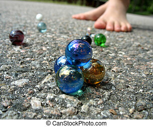 Play marbles 4 - A pyramid of marbles with kids around to...