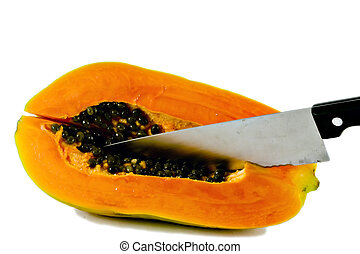 papaya series2 - Isolated shot of a papaya being cut with a...