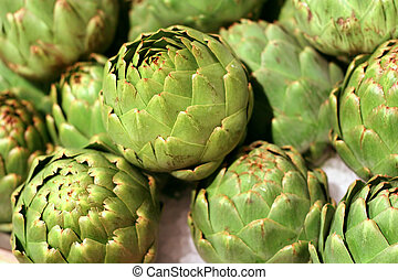 Artichokes - Fresh Green Artichokes on ice in a market