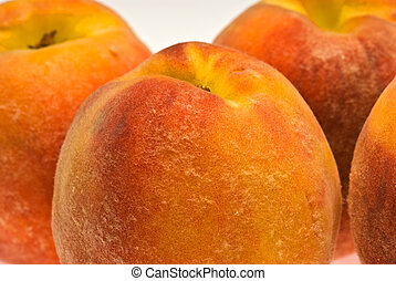 peaches close up - a macro shot of peaches showing fuzz and...