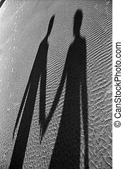 Shadow of couple - Newlyweds holding hands on beach