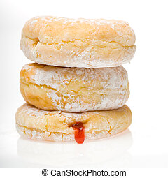 stack of powdered donuts - a stack of three jelly powdered...